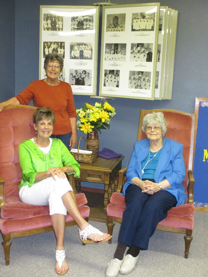 Lois (Danielson) Carlson (standing) with Luella (Danielson) Holwerda (left) and Eleanor (Danielson) Anderson (right) At Messiah Church, Lindsborg, Kansas, on July 18, 2017